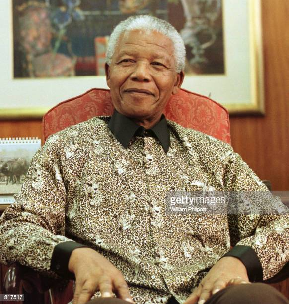 Former President of South Africa Nelson Mandela poses for photographers in the South African embassy in Washington DC October 22 1999 Mendela was in...