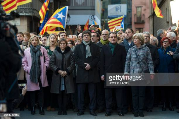 Former President of the Catalan Government and leader of Partit Democrata Europeu Catala PDECAT Artur Mas stands past President of the Catalan...