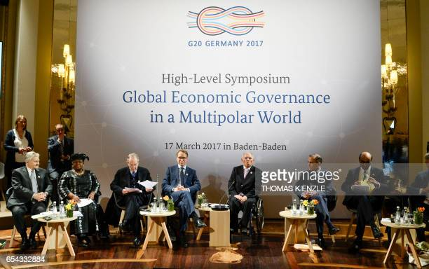 Former president of the European Central Bank JeanClaude Trichet CEO of German Bundesbank Jens Weidmann and German Finance Minister Wolfgang...