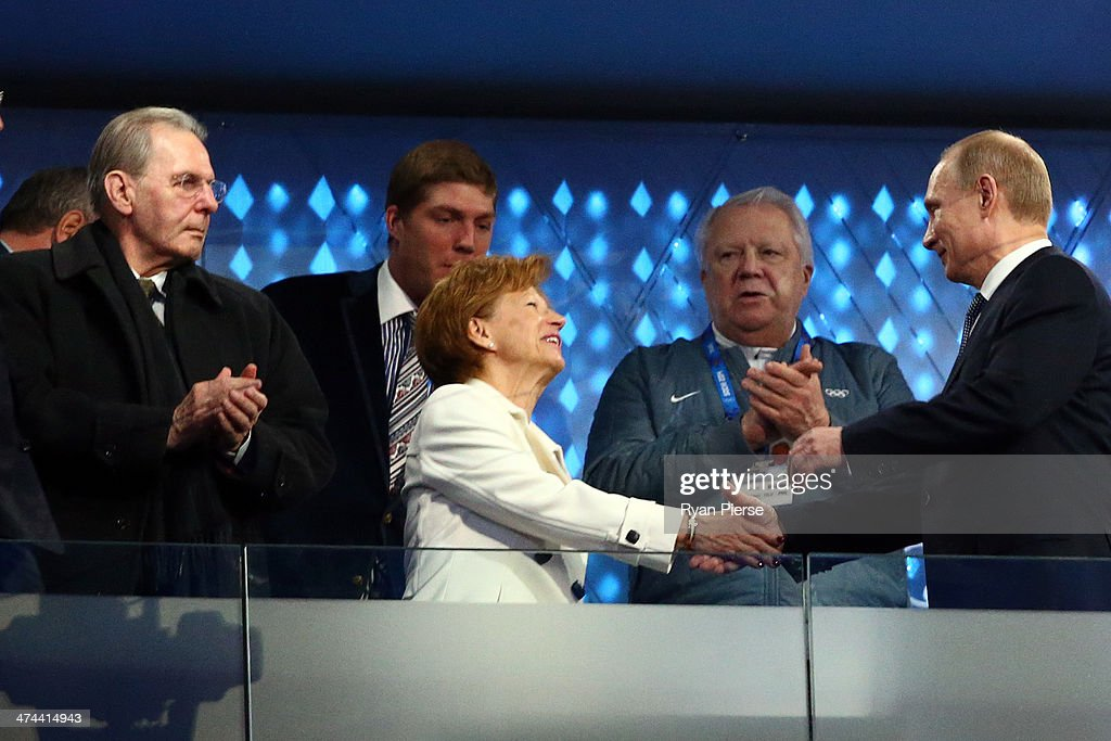 Former President of the International Olympic Committee (IOC) <a gi-track='captionPersonalityLinkClicked' href=/galleries/search?phrase=Jacques+Rogge&family=editorial&specificpeople=206143 ng-click='$event.stopPropagation()'>Jacques Rogge</a> and Claudia Bach are greeted by President of Russia <a gi-track='captionPersonalityLinkClicked' href=/galleries/search?phrase=Vladimir+Putin&family=editorial&specificpeople=154896 ng-click='$event.stopPropagation()'>Vladimir Putin</a> during the 2014 Sochi Winter Olympics Closing Ceremony at Fisht Olympic Stadium on February 23, 2014 in Sochi, Russia.
