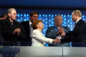 Former President of the International Olympic Committee Jacques Rogge and Claudia Bach are greeted by President of Russia Vladimir Putin during the...