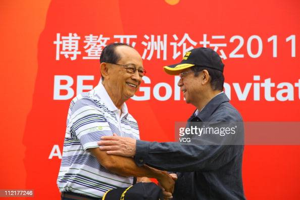 Former President of the Philippines Fidel Valdez Ramos shakes hands with Japanese former Prime Minister Fukuda Yasuo during the BFA Golf Invitation...