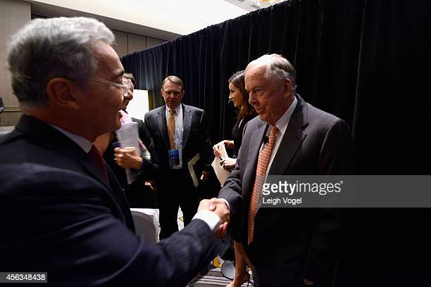 Former President of the Republic of Colombia Alvaro Uribe Velez and Founder Chairman of BP Capital Management T Boone Pickens meet backstage at the...