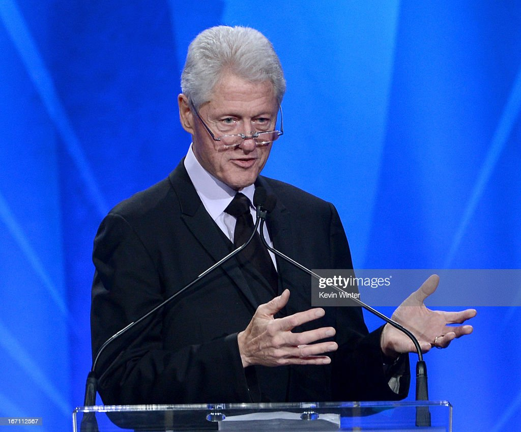 Former President of the United States <a gi-track='captionPersonalityLinkClicked' href=/galleries/search?phrase=Bill+Clinton&family=editorial&specificpeople=67203 ng-click='$event.stopPropagation()'>Bill Clinton</a> accepts the Advocate for Change Award onstage during the 24th Annual GLAAD Media Awards at JW Marriott Los Angeles at L.A. LIVE on April 20, 2013 in Los Angeles, California.