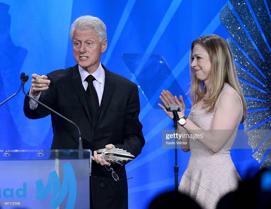 Former President of the United States <a gi-track='captionPersonalityLinkClicked' href=/galleries/search?phrase=Bill+Clinton&family=editorial&specificpeople=67203 ng-click='$event.stopPropagation()'>Bill Clinton</a> accepts the Advocate for Change Award with <a gi-track='captionPersonalityLinkClicked' href=/galleries/search?phrase=Chelsea+Clinton&family=editorial&specificpeople=119698 ng-click='$event.stopPropagation()'>Chelsea Clinton</a> onstage during the 24th Annual GLAAD Media Awards at JW Marriott Los Angeles at L.A. LIVE on April 20, 2013 in Los Angeles, California.