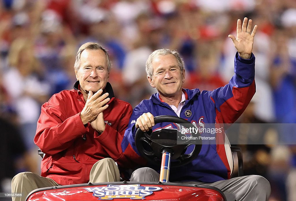 Former President of the United States George W Bush and his father Former President George HW Bush wave to the crowd before the Texas Rangers host...