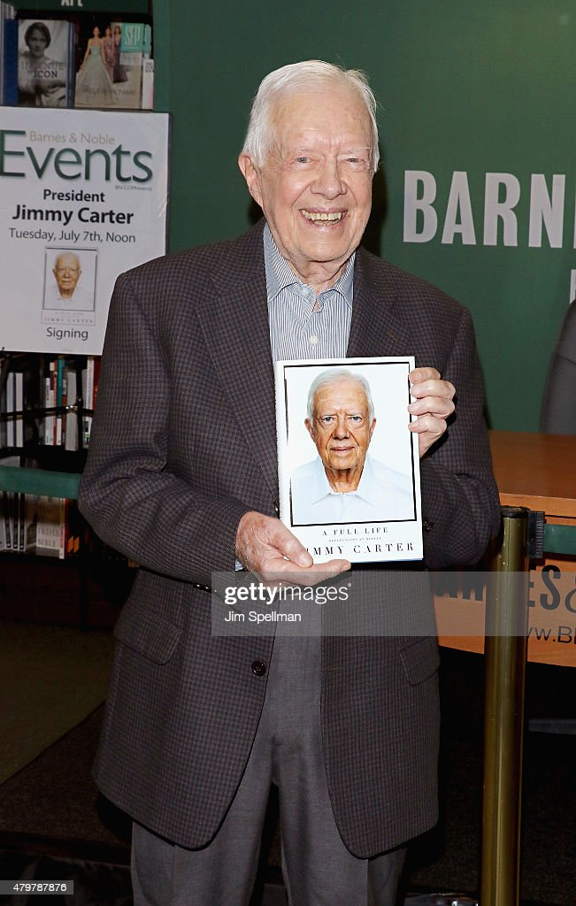 Former President of the United States <a gi-track='captionPersonalityLinkClicked' href=/galleries/search?phrase=Jimmy+Carter+-+US+President&family=editorial&specificpeople=93589 ng-click='$event.stopPropagation()'>Jimmy Carter</a> signs copies of 'Full Life: Reflections at Ninety'at Barnes & Noble, 5th Avenue on July 7, 2015 in New York City.