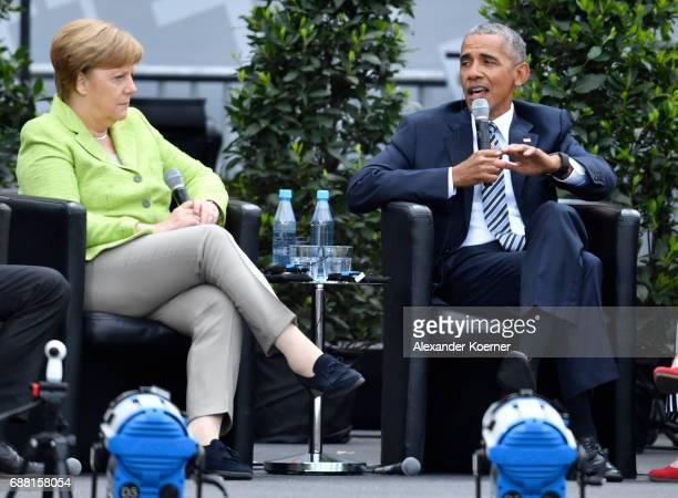 Former President of the United States of America Barack Obama and German Chancellor Angela Merkel speak on stage at the Brandenburg Gate during the...