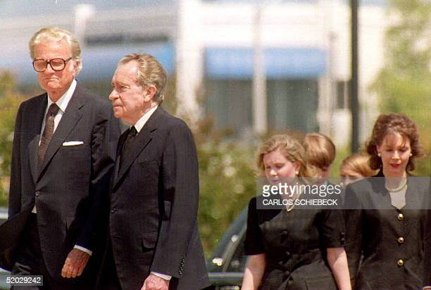 Former President Richard Nixon is accompanied by evangelist Billy Graham as they arrive at the Richard Nixon Library 25 June 1993 where former First...