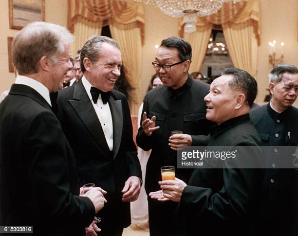 Former President Richard Nixon President Jimmy Carter and Chinese Deputy Premier Deng Xiaoping speak at a state dinner in honor of Deng's visit to...