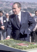 Former President Richard Nixon visits the proposed construction site for the Richard Nixon Presidential Library and Birthplace on March 30 1984 in...