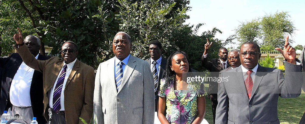 Former President Rupiah Banda flanked by MMD acting party president Michael Mabenga wife Thandiwe and elections' chairman Grabriel Namulambe poses...