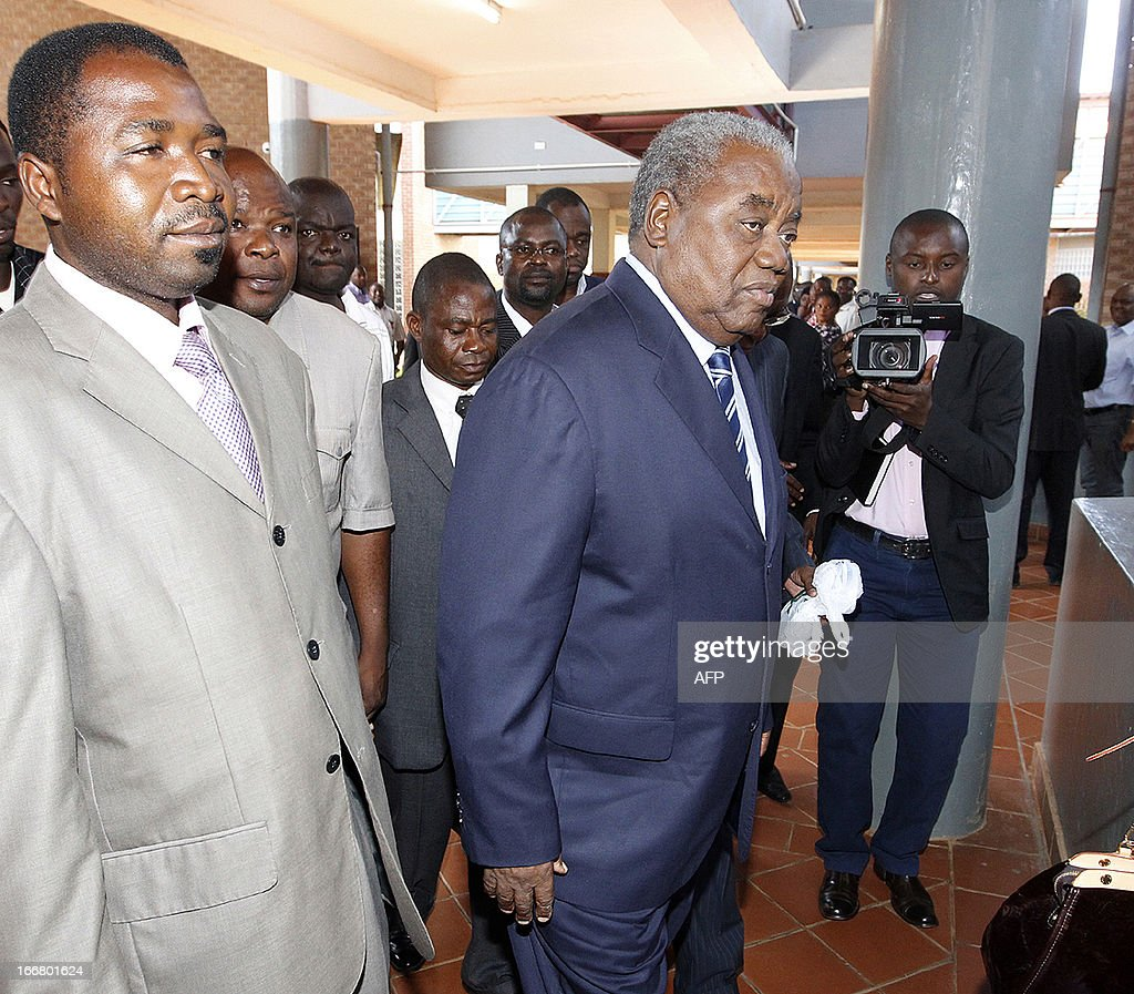 Former president Rupiah Banda is escorted by sympathisers on April 17 2013 at the Lusaka Magistrate Court as he faces charges of abuse of authority...