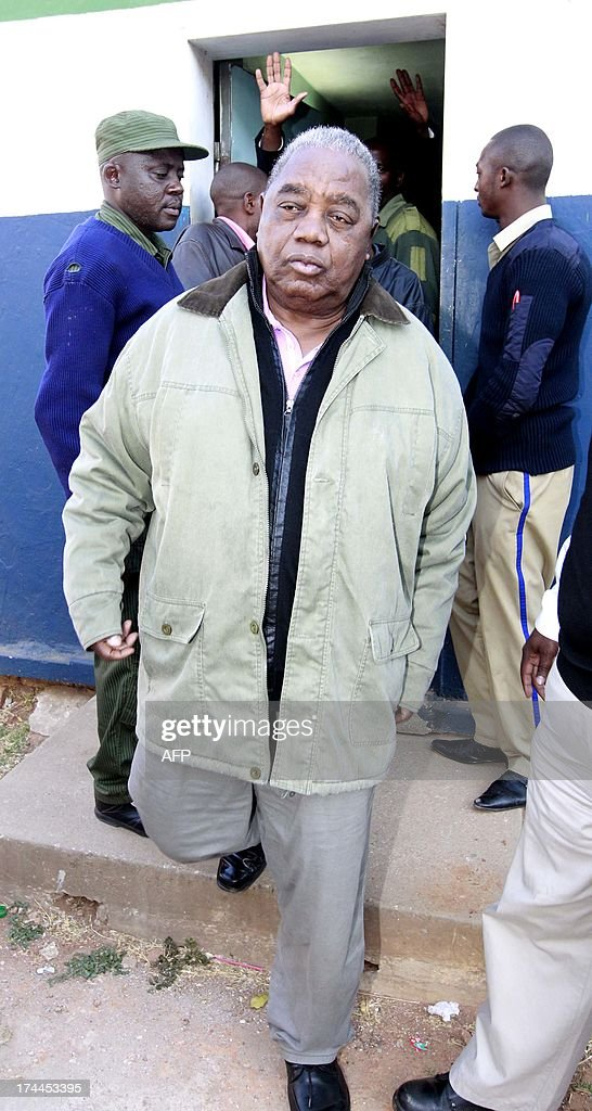 Former President Rupiah Banda leaves the holding cell at Woodlands police station Lusaka after visiting his son Andrew who was arrested on July 25...