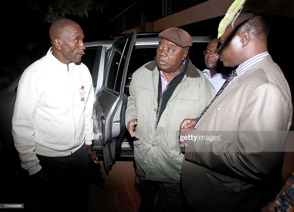 Former President Rupiah Banda talks to his son Andrew who was arrested and briefly detained at Woodlands police station Lusaka on July 25 2013 for...