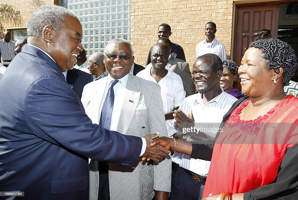 Former president Rupiah Banda thanks his supporters outside the Lusaka Magistrate Court on April 17 as he faces charges of abuse of authority of...