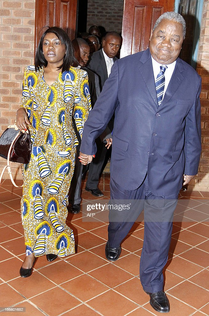 Former president Rupiah Banda walks with his wife Thandiwa Banda on April 17 2013 at the Lusaka Magistrate Court as he faces charges of abuse of...