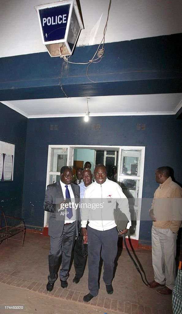 Former President Rupiah Banda's son Andrew is escorted by his lawyers from police cells on July 25 2013 at Woodlands police station after being...