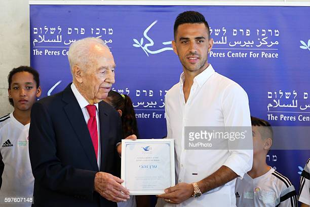 Former President Shimon Peres appoints footballer Eran Zahavi who plays in the Chinese League as Ambassador For Peace In Sport in a ceremony attended...