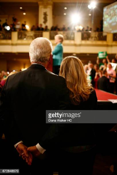 Former President William Clinton and daughter Chelsea Clinton are photographed looking on as Senator Hillary Rodham Clinton gives her victory speech...