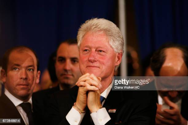 Former President William Clinton is photographed looking on as Senator Hillary Rodham Clinton gives her victory speech on April 22 2008 at the Park...