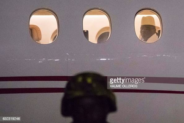 TOPSHOT Former president Yaya Jammeh the Gambia's leader for 22 years looks through the window from the plane as he leaves the country on 21 January...