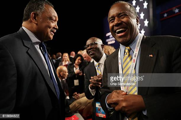 Former presidential candidate Dr Ben Carson speaks with Jesse Jackason before the start of the third US presidential debate at the Thomas Mack Center...