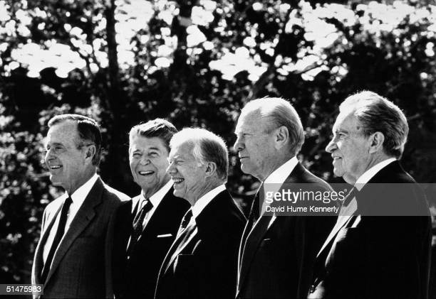 Former Presidents George HW Bush Ronald Reagan Jimmy Carter Gerald Ford and Richard Nixon pose during the Ronald Reagan Library dedication November 4...