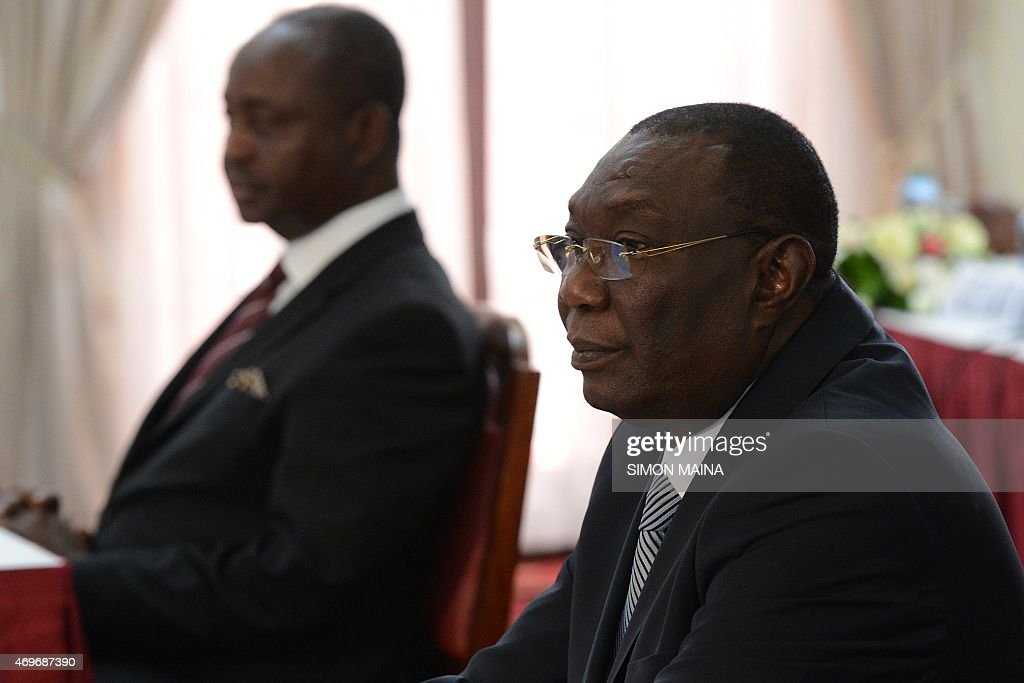 Former presidents of the Central African Republic Michel Djotodia (R) and François Bozize (background) wait, on April 14, 2015 in Nairobi, prior to sign a ceasefire deal after months of negotiations mediated by Kenya. AFP PHOTO/SIMON MAINA