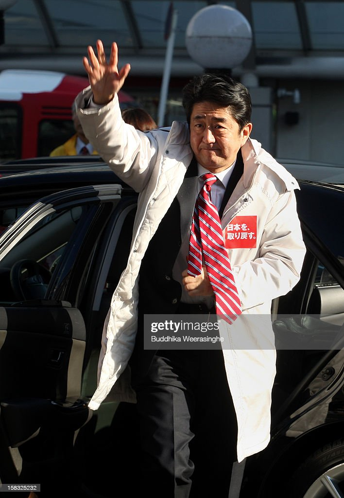 Former Prime Minister and leader of Japan's main opposition Liberal Democratic Party (LDP) <a gi-track='captionPersonalityLinkClicked' href=/galleries/search?phrase=Shinzo+Abe&family=editorial&specificpeople=559017 ng-click='$event.stopPropagation()'>Shinzo Abe</a> arrives for an election campaign rally on December 13, 2012 in Osaka, Japan. Japanese voters will go to the polls for a general election on December 16, 2012.