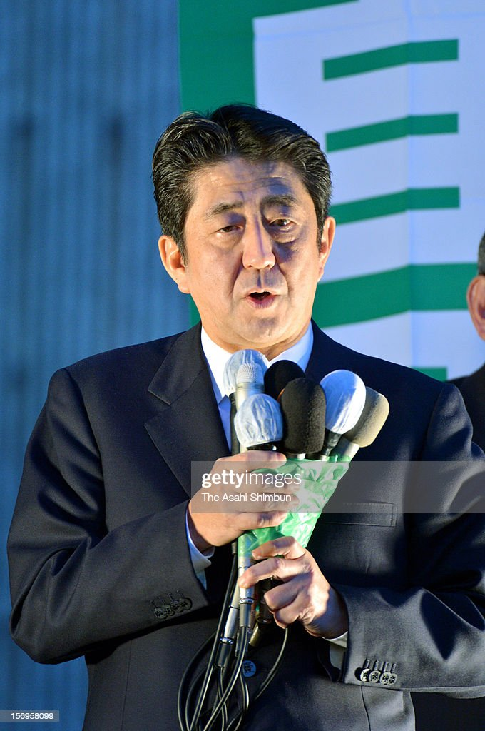 Former Prime Minister and opposition Liberal Democratic Party (LDP) president <a gi-track='captionPersonalityLinkClicked' href=/galleries/search?phrase=Shinzo+Abe&family=editorial&specificpeople=559017 ng-click='$event.stopPropagation()'>Shinzo Abe</a> makes a street speech on November 25, 2012 in Tsu, Mie, Japan. Japanese people vote in the general election on December 16.