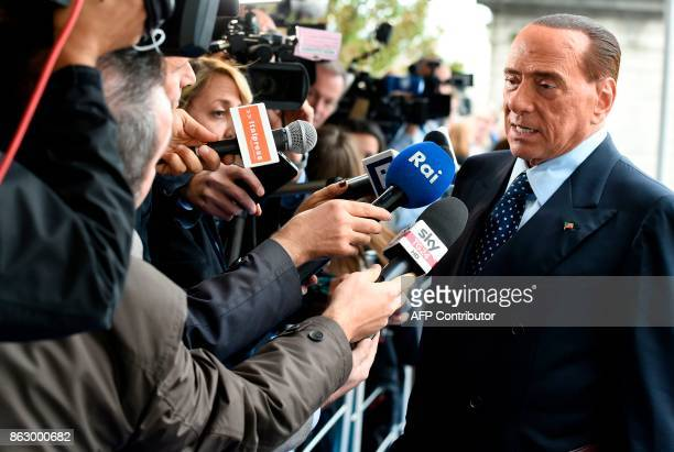 Former Prime Minister and president of Italian rightwing party Forza Italia Silvio Berlusconi speaks to journalists as he arrives at a meeting of the...