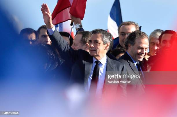 Former Prime Minister and Presidential Candidate Francois Fillon salutes voters after a political meeting at Trocadero on March 5 2017 in Paris...