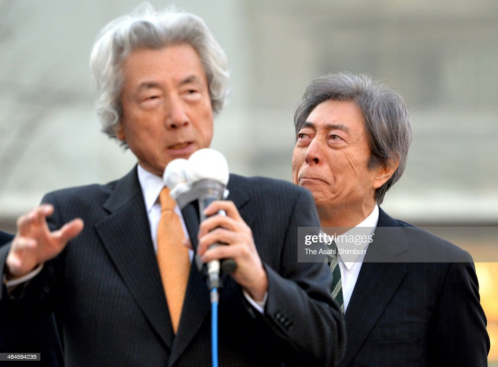 Former Prime Minister and Tokyo Gubernatorial election candidate Morihiro Hosokawa (R) tears up as he listens to a support speech by former Prime Minister Junichiro Koizumi (L) during a street speech on January 23, 2014 in Tokyo, Japan. Campaigning officially kicked off in the race for a new governor of Tokyo, a closely watched contest with the future of the nation's nuclear energy policy shaping up to be a key issue.
