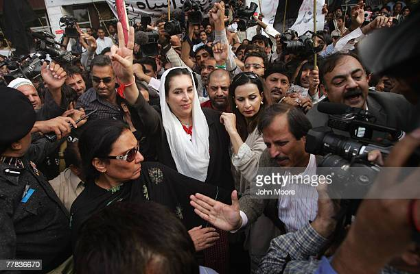 Former Prime Minister Benazir Bhutto flashes a victory sign while addressing a protest of journalists November 10 2007 in Islamabad Pakistan Bhutto...