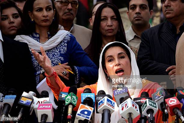 Former prime minister Benazir Bhutto speaks to media outside her residence on November 16 in Lahore Pakistan The government placed Bhutto under house...