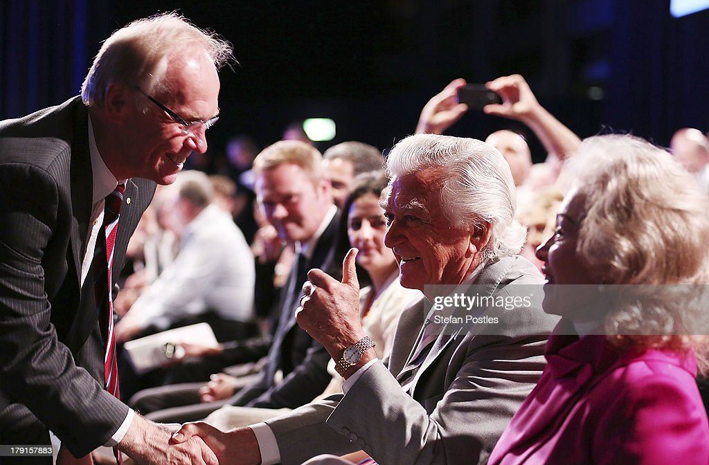 Former Prime Minister Bob Hawke shakes hands with Peter Beattie at the Labor Party Launch at the Brisbane Convention and Exhibition Centre on September 1, 2013 in Brisbane, Australia. The incumbent centre-left Australian Labor Party has trailed the conservative Liberal-National Party coalition for the first four weeks of the campaign, and most pollsters give them little hope of retaining government. Australians head to the polls this Saturday, September 7.