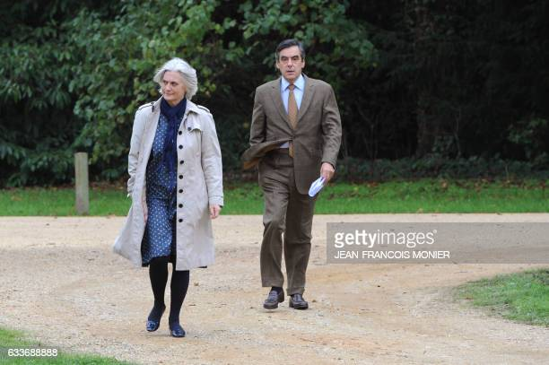 Former Prime minister Francois Fillon and his wife Penelope arrive for a reception in the stables of the SablesurSarthe castle northwestern France on...