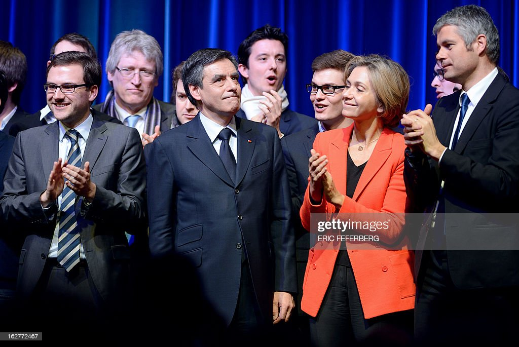 Former Prime minister Francois Fillon (C) is congratulated by UMP general secretary, Valerie Pecresse (2ndR) and former minister Laurent Wauquiez after his speech during a meeting on February 26, 2013 in Paris.