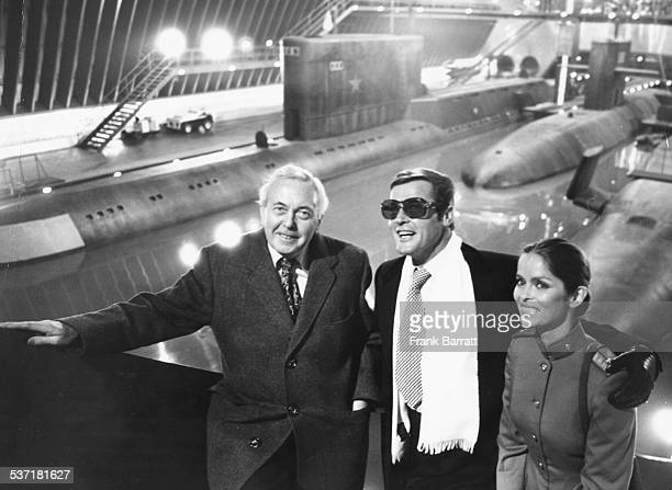 Former Prime Minister Harold Wilson with actors Roger Moore and Barbara Bach on the new 1 million James Bond set at Pinewood Studios England December...