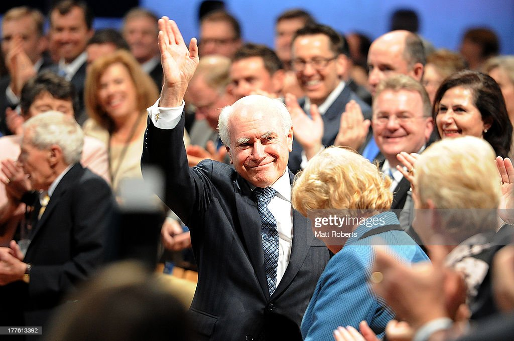Former Prime Minister John Howard is welcomed during the 2013 Coalition Campaign Launch at the Queensland Performing Arts Centre on August 25, 2013 in Brisbane, Australia. Opposition Leader Tony Abbott outlined the coalition plans if it wins the election on September 7. In his speech Abbott spoke of policies already largely released, including the abolition of a tax on carbon and mining, and the introduction of a Paid Parental Leave program. Tony Abbott was introduced to stage by his daughters Bridget and Frances, and after introductory speeches by Queensland Premier Campbell Newman, Liberal Deputy Leader Julie Bishop, and Nationals Leader Warren Truss.