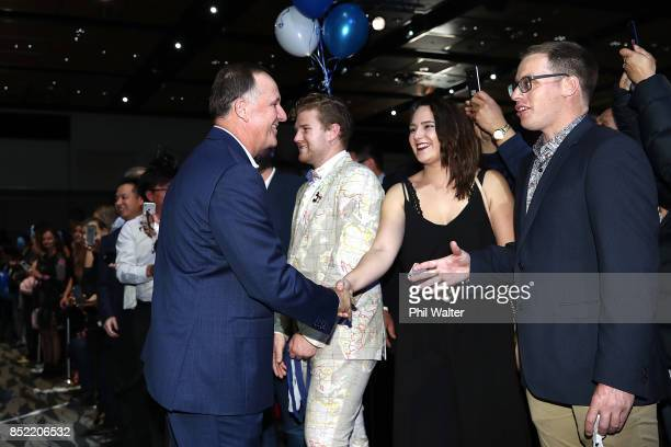 Former Prime Minister John Key greets supporters on September 23 2017 in Auckland New Zealand With results too close to call no outright winner...