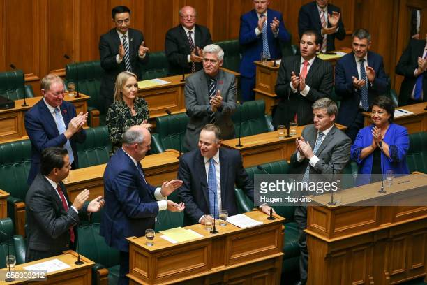 Former Prime Minister John Key is applauded by fellow National MPs after delivering his farewell speech at Parliament on March 22 2017 in Wellington...