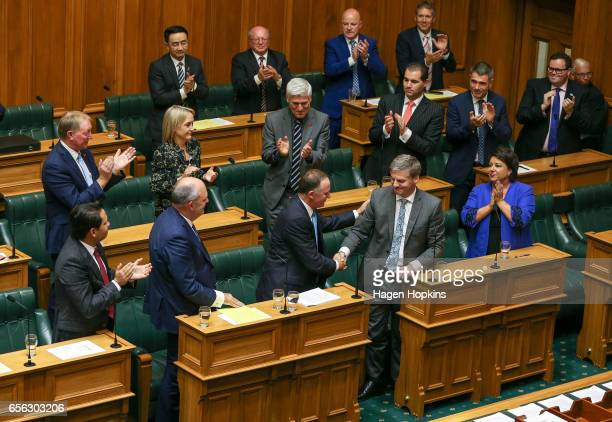 Former Prime Minister John Key is shakes hands with current Prime Minister Bill English after delivering his farewell speech at Parliament on March...