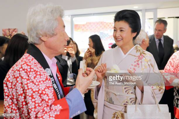 Former Prime Minister Junichiro Koizumi and actress Norika Fujiwara talk during the event to harvest rice from a rice paddy at Pasona Holdings...
