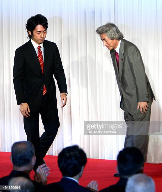 Former Prime Minister Junichiro Koizumi introduces his second son Shinjiro as his successor during an introduction meeting with his supporters on...