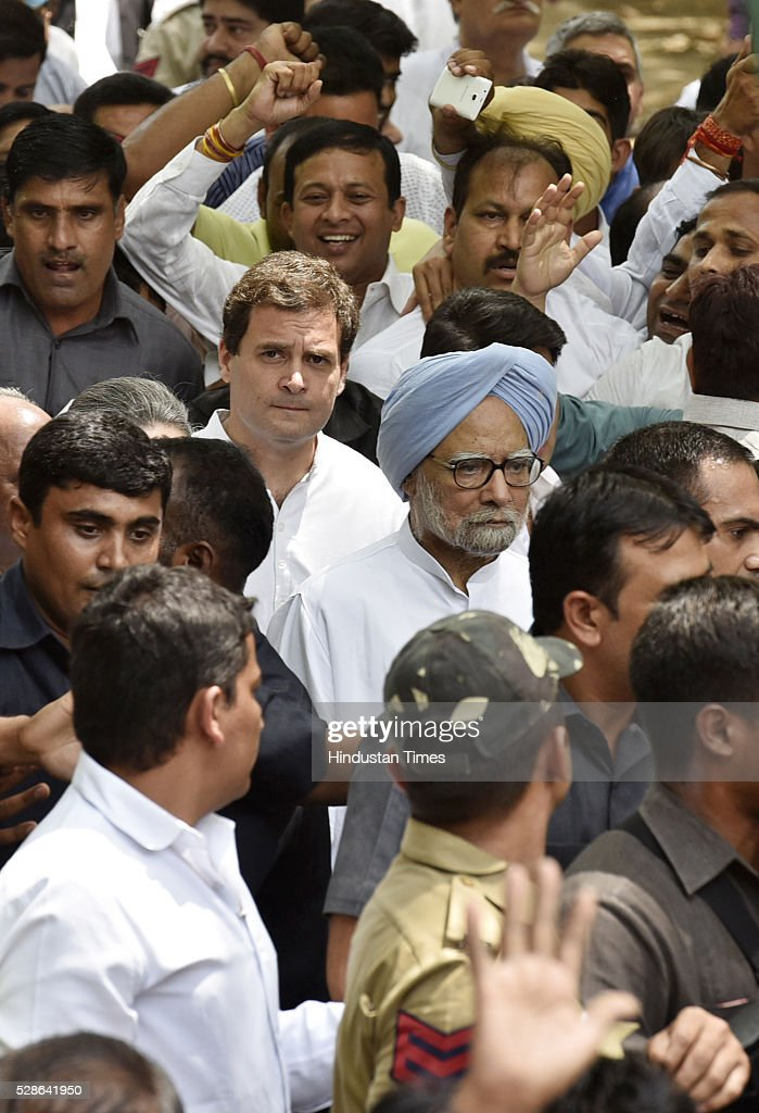 Former Prime Minister Manmohan Singh, Congress Vice President Rahul Gandhi and other Congress leaders during the Save Democracy march from Jantar Mantar to Parliament Streeton May 6, 2016 in New Delhi, India. The protest march called to highlight what the Congress party terms as Modis attack on democracy saw thousands of party workers gather at Jantar Mantar, the countrys protest capital. Congress president Sonia Gandhi, party vice-president Rahul Gandhi and former prime minister Manmohan Singh were briefly arrested and then released at the Parliament Street police station.