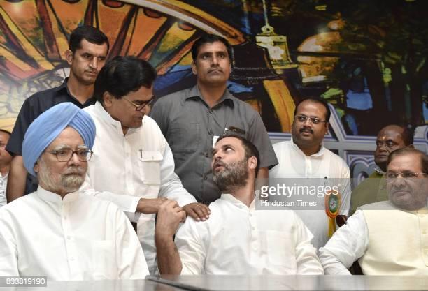 Former Prime Minister Manmohan Singh Congress Vice President Rahul Gandhi with Sharad Yadav and Samajwadi party leader Prof Ram Gopal Yadav during...