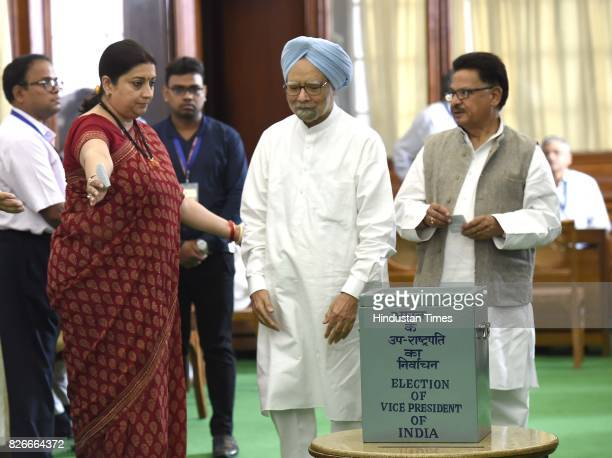 Former Prime Minister Manmohan Singh with Smriti Irani Union Minister for IB cast his vote for Vice Presidential Election at Parliament House on...