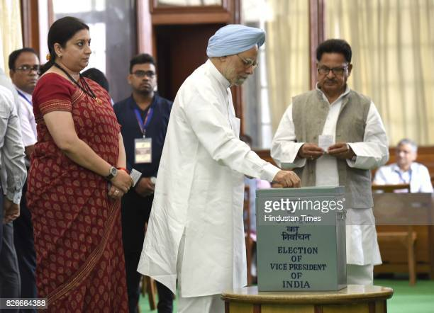 Former Prime Minister Manmohan Singh with Smriti Irani Union Minister for IB casts his vote for Vice Presidential Election at Parliament House on...